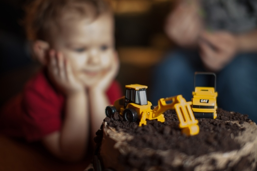 When he first saw the cake, two year old Everett placed his elbows on the table and just stared at the cake dreamily.