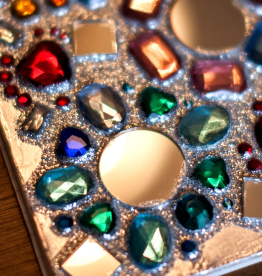 Plastic gems and glass mirrors are glued on the notebook cover.