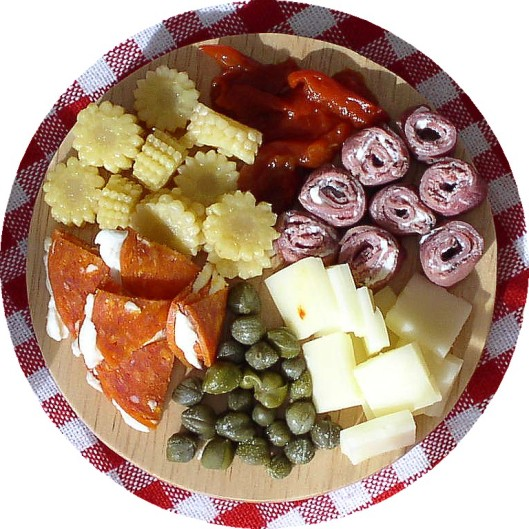NOT made of clay, this antipasto tray contains real, delicious ingredients.
