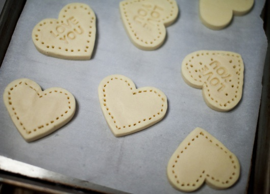 One side of the cutter featured Valentine's Day sentiments, which were pressed into the shortbread. We also used a fork to press holes around the edges of the cookies.