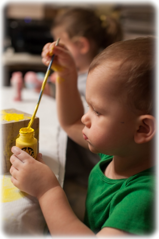 "Grandson vigorously plunges the brush into the almost empty acrylic paint. ""This is sticky! This is sticky!"""