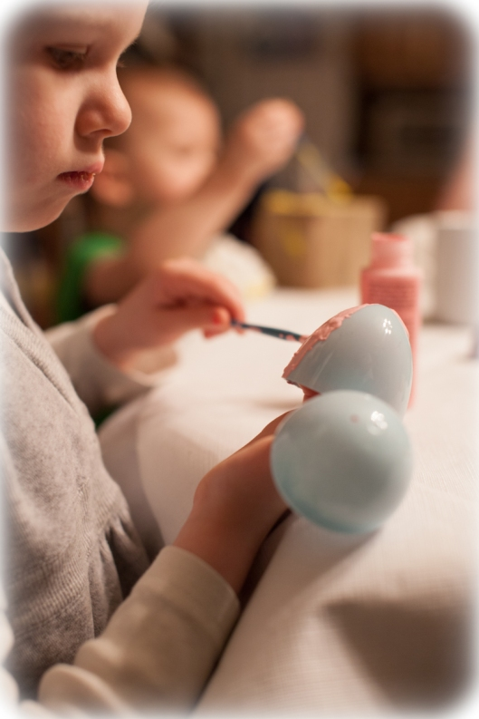 Painting the plastic Easter Eggs.
