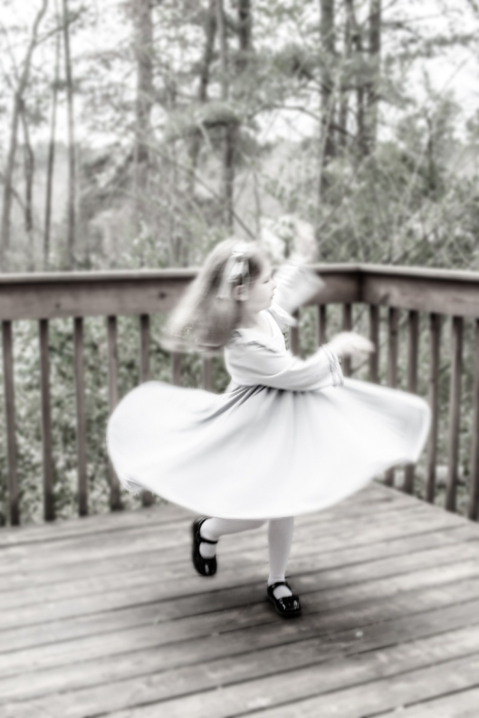 My granddaughter spins  in her Spinning Tales dress.