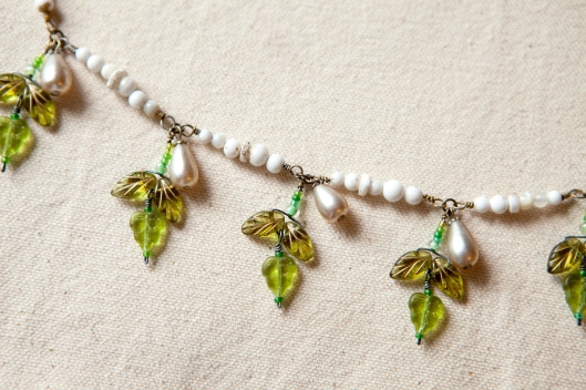 The sections of white beads are attached and the leaf clusters have been added. I love the bracelet just the way it is here!