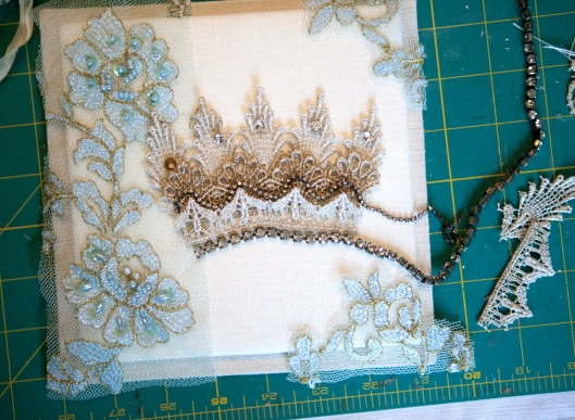 Trying out pieces of lace for the crown.