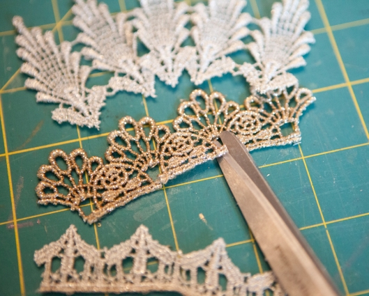 Snipping the lace so it curves better.