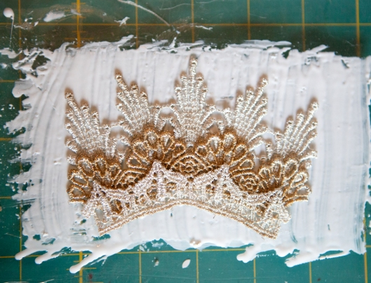 The assembled crown is laid on wet tacky glue.