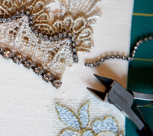 Jewelry cutters are used to cut the rhinestone chain to size.