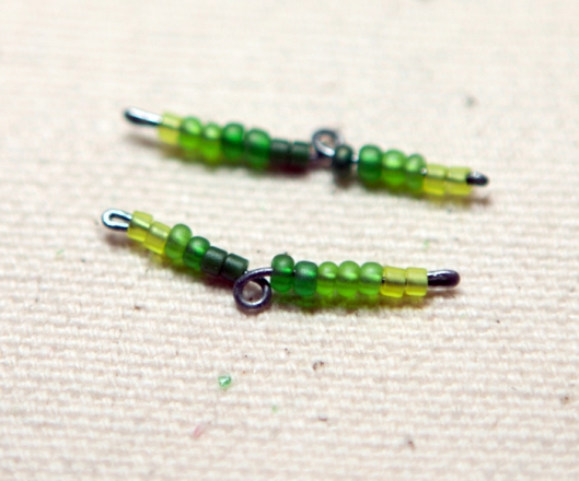 Two beaded wires ready to place on the flower wire.