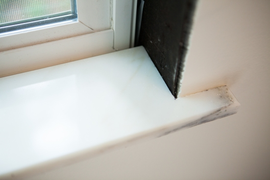 The marble sill pressed in place.
