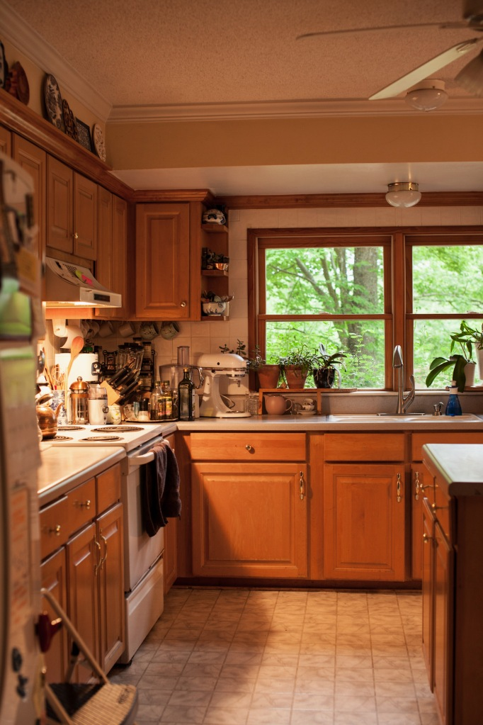 Kitchen BEFORE the remodel. Notice how dark the space is.