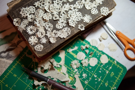 Tiny snowflakes cut from a vintage dictionary page.