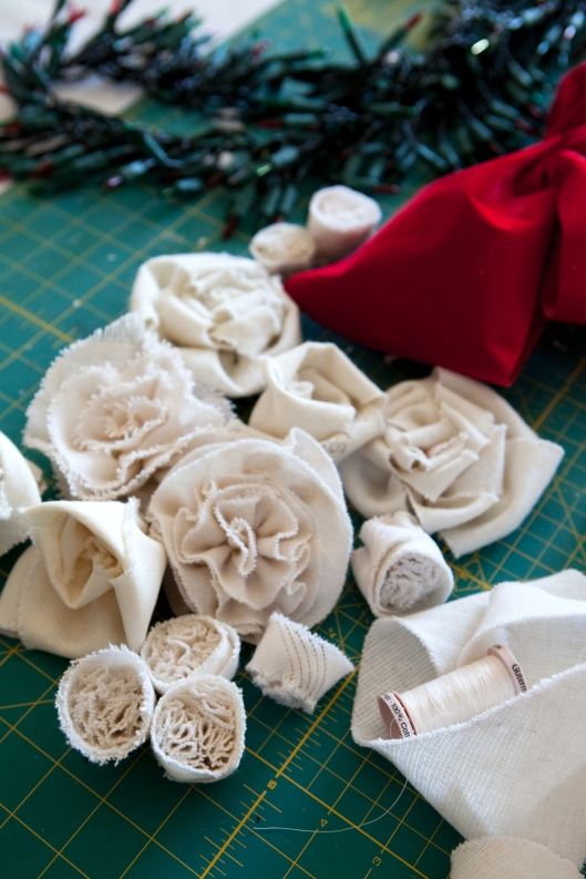 On my worktable - roses, rosettes and ruffle buds made from men's tie wool  interlinings.