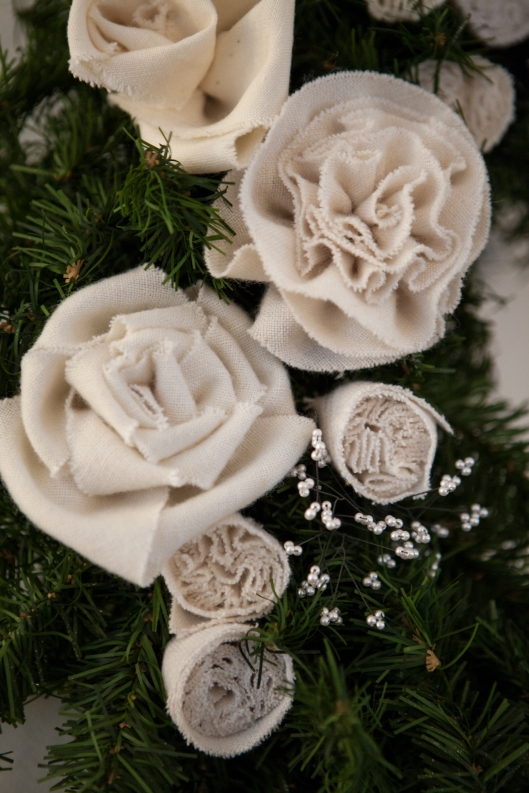 Roses, rosettes and sushi buds made from the wool interlinings of men's ties.