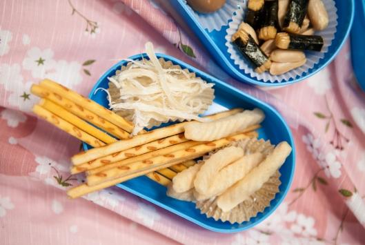 Top to bottom: Dried squid, Pretz Sticks, Shrimp Puffs.