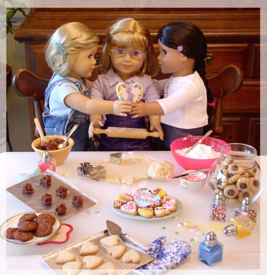 American Girl dolls, Kit, Nellie and Josefina, bake Valentine cookies together.