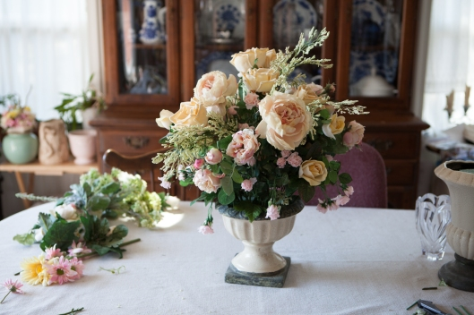 artificial flower arrangements for living room. the arrangement for living room table. velvet-petal roses are showing their artificial flower arrangements e