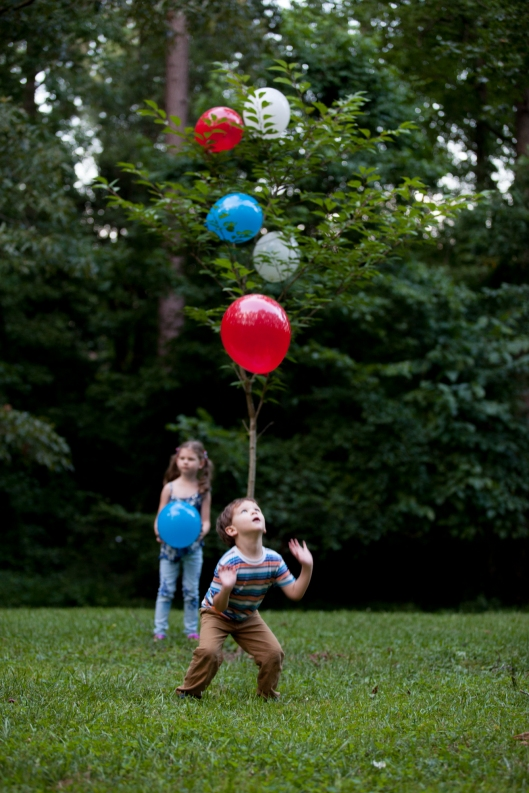 The kids play with red, white and blue balloons on July 4th.