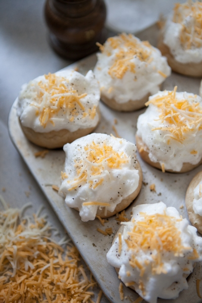 Sprinkle grated cheese on top of the meringues.