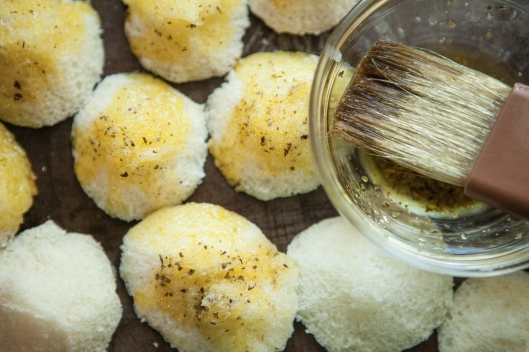 The little cutouts from the rolls are brushed with herb dipping oil and baked in on a separate pan.