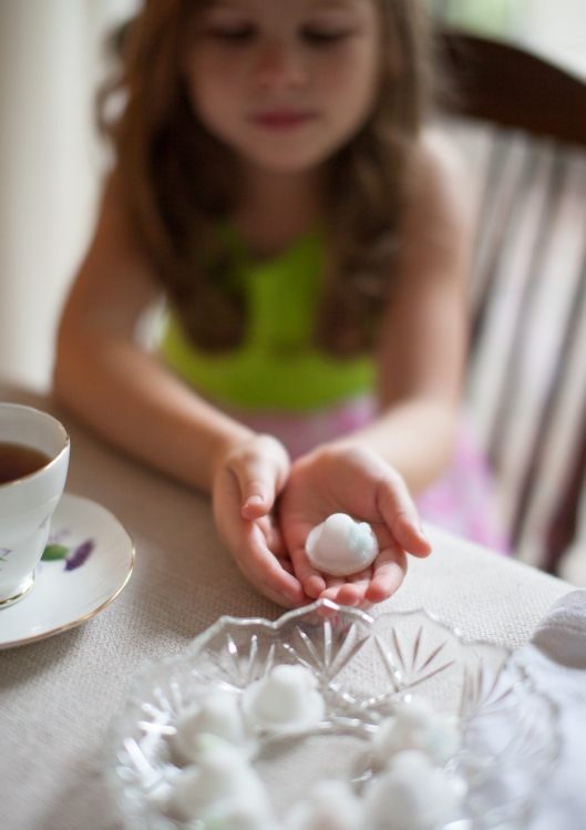 My granddaughter hold a little Sugar Bonnet before dropping it in her tea.