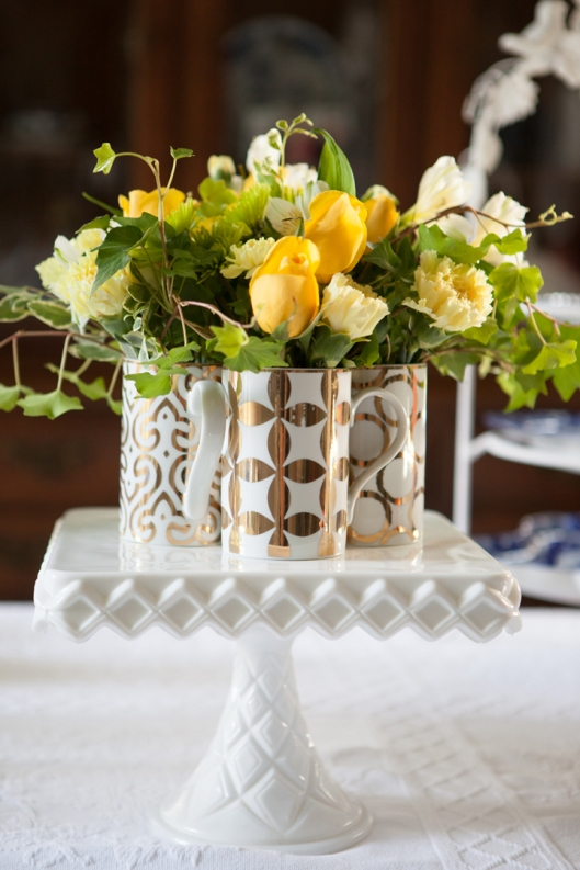 "Rosanna's Luxe Moderne Mugs make the perfect ""vase"" for the flower arrangement."