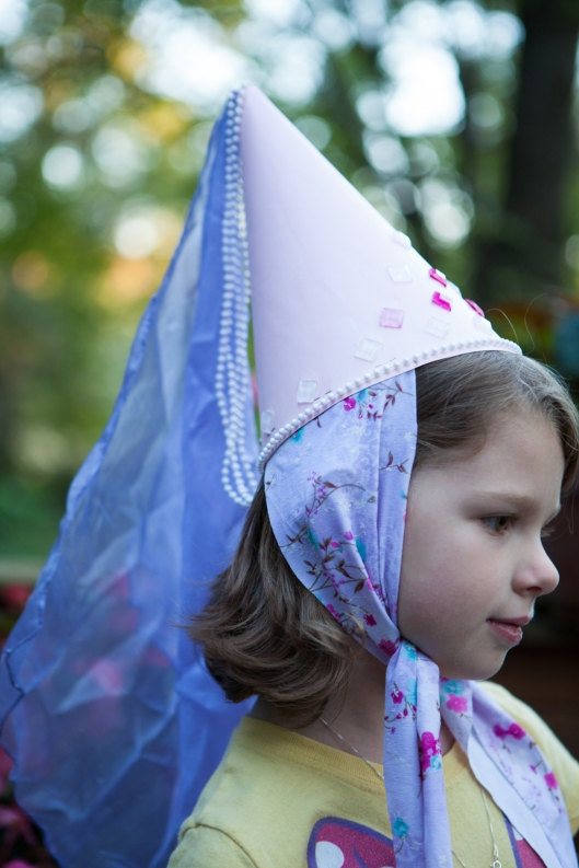 Granddaughter in her princess cone hat.