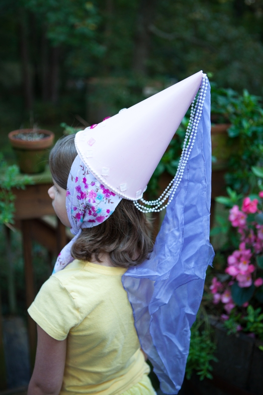 Princess hat made of poster board, fabric, gems and pearls.