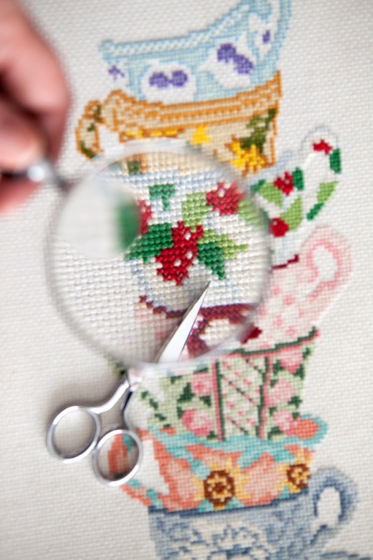 Teacups cross stitch - the red was too bright so I cut out all the stitches.