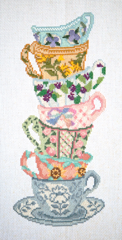 Teacups cross stitch, with pretty purple berries and a softer bow on the pink teacup.