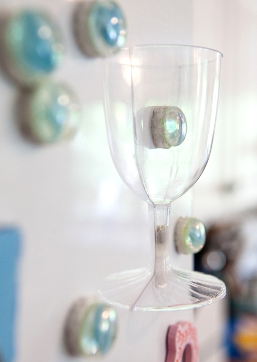 Half a wine glass on my fridge!  It looks really cute with the marble counters in it.