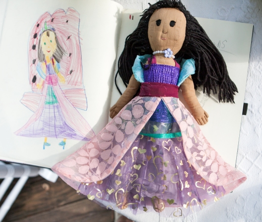 There are three separate pieces: The lavender underskirt, the dress with all the sheer layers and stiff aqua collar sewn in the side seams, and the wide burgundy sash.