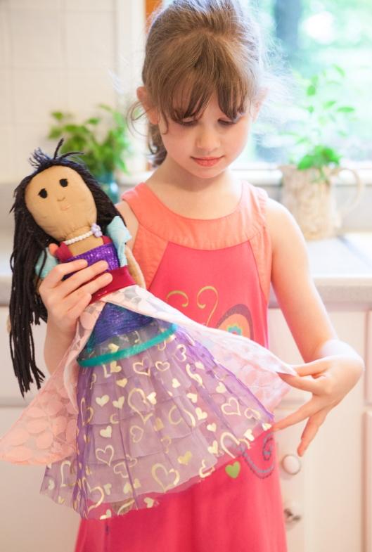 17 still loving her doll