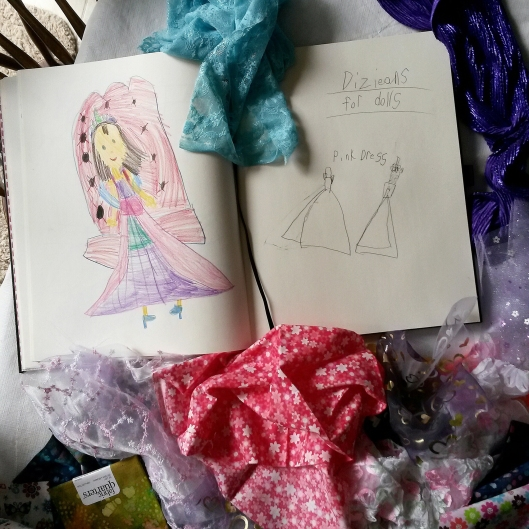 Matching fabrics to make the Princess doll dress in her sketch.