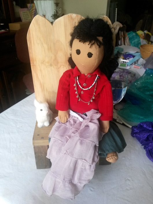 She couldn't part with her doll and took it home so I had to use my own doll for fittings.
