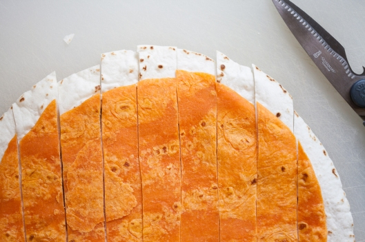 Strips of white Mission flour tortilla and orange Habanero Lime tortilla.