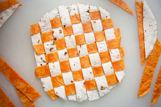 Spicy Habanero Lime tortillas are woven together with a white flour tortilla.