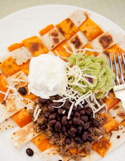 Woven Tortillas, served with taco meat, black beans, guacamole, sour cream and cheddar cheese. Use knife and fork to eat.