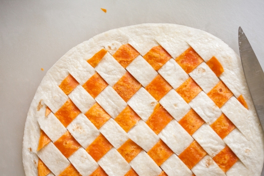 Strips of Habanero tortilla are woven through slits in a white flour tortilla.