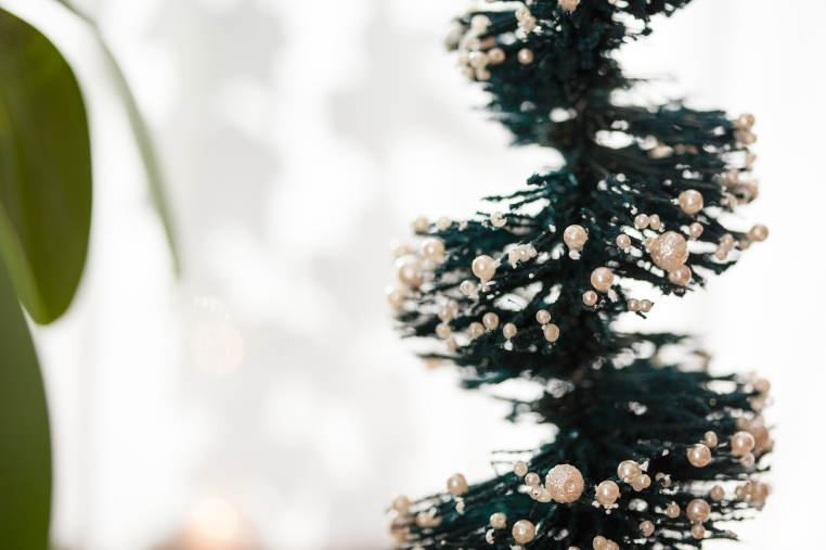 Pearls are glued to the tips of bristles on this Bottle Brush Topiary Tree.