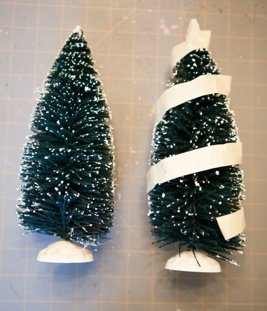 The masking tape is wound around the tree, starting at the bottom and spiraling around the tree to the top. The tape will mark all the places that the bristles will NOT be cut.