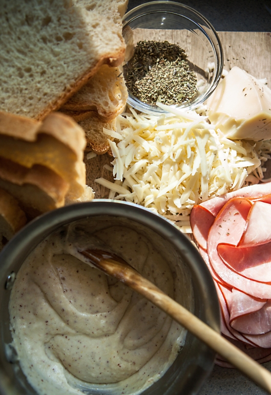 Ingredients for Croque Monsieur. Sliced homemade bread, sliced ham, gruyere cheese, Herbs de Provence, mustard bechemel.