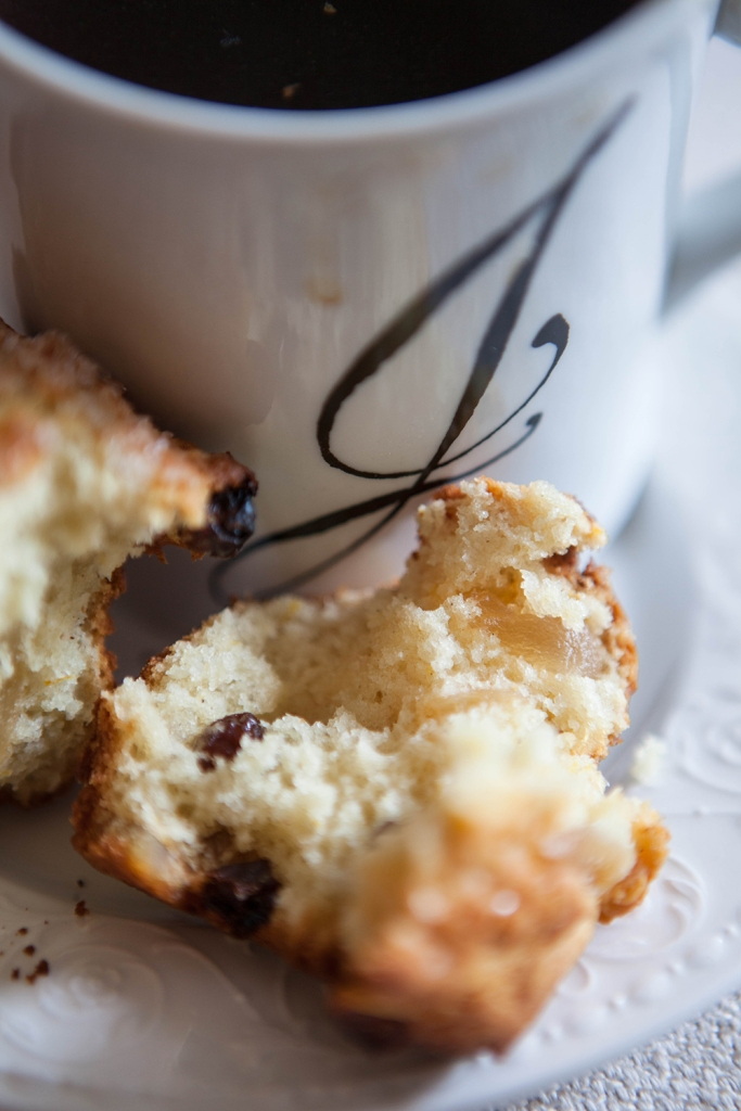 Spicy bits of crystalized ginger and raisins stud this ginger & cardamom muffin.