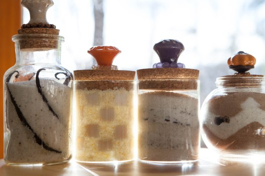 Delicious and beautiful flavored sugars in jars.