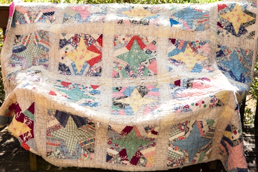 This old quilt is actually inside the red, white and blue quilt, which has been turned inside out.