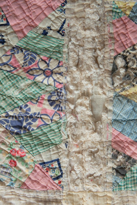 The tattered sections of the quilt are beautiful to me.