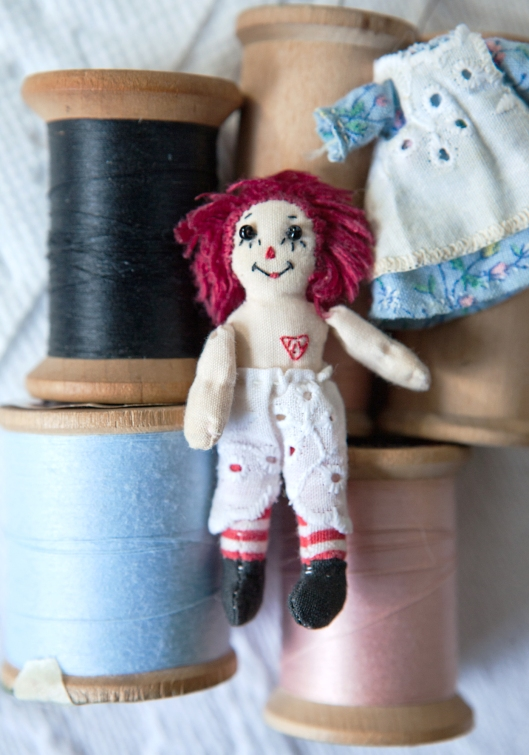 Tiny Raggedy Ann with her ILY heart